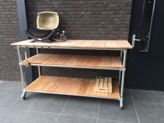 Barbecue tafel steigerbuizen en -hout.