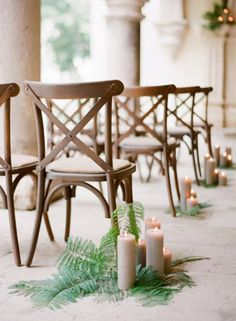 Wedding aisle décor with wooden chairs, ferns, and candles // Pinned by Dauphine Magazine x Castlefield - Curated by Castlefield Bridal & Branding Atelier and delivering the ultimate experience for the haute couture connoisseur! Visit www.dauphinemagazine.com, @dauphinemagazine on Instagram, and @dauphinemag on Pinterest • Visit Castlefield: www.castlefield.co and @ castlefieldco on Instagram / Luxury, fashion, weddings, bridal style, décor, travel, art, design, jewelry, photography, beauty