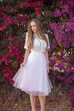 polka dot lace boxy crop top, pink tulle skirt, flower wall photoshoot, golden hour, street chic, elegant spring fashion