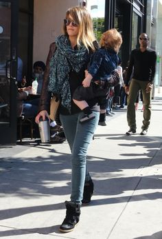 Jessica Alba took a sunny stroll in LA in colored denim, a matching printed scarf, and black Isabel Marant sneakers.