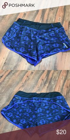 Purple & Black Reebok Shorts Purple and black print Reebok Shorts. Looser fitting with built in underwear. Reebok Shorts