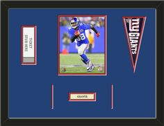 One framed 8 x 10 inch New York Giants photo of Hakeem Nicks with a New York Giants mini pennant, a customizable nameplate*, and openings for 1 or 2 ticket stubs**, double matted in team colors to 24 x 18 inches.  (Pennant design may change)  $109.99  @ ArtandMore.com