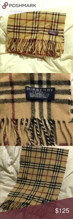 Burberry Scarf *Preowned *Burberry London  *100% Lambswool *Authentic  *Dry Clean Only *stretched out see last pictures *edges have damage *Make Me An Offer Burberry Accessories Scarves & Wraps