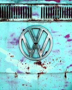 Rusting grill of aqua colored Volkswagen bus