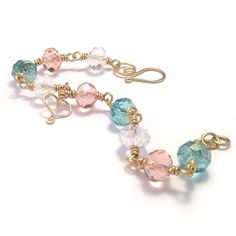 Pretty pastel bracelet handmade using lovely crystal glass beads in turquoise, coral and clear, wrapped with brass wire and adorned with a cute handcrafted wire heart ~ by Kian Designs Handmade Jewellery