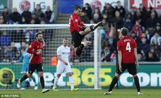 Ibrahimovic celebrates his goal with a Kung Fu kick towards team-mate Phil Jones