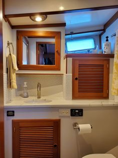 Stateroom head - we replaced the countertop, sink and faucet and tilled the backsplace, a new toilet was installed and the walls were painted. Bainbridge Island, New Toilet, House Renovations, Moving Out, Faucet, Countertops, Sink, Walls, Mirror