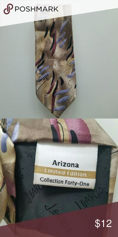 LIMITED EDITION Jerry Garcia Tie Beautiful tan and purple tie. Limited Edition from J. Garcia. Arizona Collection Forty-One. Very clean . Not new but in great condition! J. Garcia Accessories Ties
