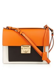 Introduce crisp Italian style to your summer repertoire with Salvatore Ferragamo's burnt-orange smooth-leather Marisol shoulder bag. The off-white side panels and black front pocket lend it graphic appeal, and it's finished with luxurious gold-tone hardware. Attach the shoulder strap and tote it alongside equally vivid ensembles.