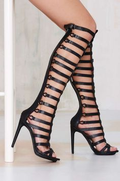 Knee-high gladiator heels featuring a zip closure at back and a buckle closure at top. #streetstyle #shoes #heels