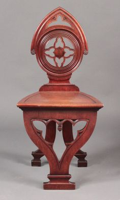 One of the strangest chairs I've ever seen:  an unusual George III Gothic mahogany hall chair, circa 1800.