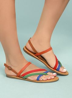 Complete your vacay or festival look with Kalene Orange Multi Flat Sandals! Orange, red, green, and blue straps of vegan leather start at an overlapping toe thong upper, and continue into an adjustable quarter strap with bronze buckle. Women's Shoes, Shoes Flats Sandals, Sandals Outfit, Flat Sandals, Cute Shoes, Leather Sandals, Shoe Boots, Red Sandals, Heel Boots For Women