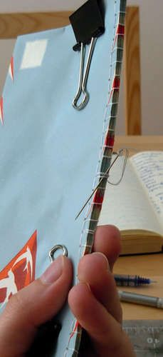 how to make an envelope book, could be good for coupons, budget, etc.