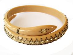 Art Deco ivory coloured celluloid snake bracelet with rhinestone and piqué detail. To fit small wrist BRA-05