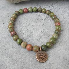 NETRA Ethnic bracelet for men, small pearls of Unakite stones, pendant Ohm, bracelet of friendship, zen, meditation, gift, This stretch bracelet in semi precious stone beads is a jewelry that can be worn every day , It is suitable for men or women. It will match with other bracelets you already have or that you can find in my shop, to perfect the stack of jewelry to your ethnic fashionable wrist. This mala style bracelet in small pearls of semi-precious stones from Unakite, (green and rusty)…