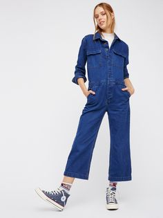 Denim Coverall | Long sleeve denim jumpsuit featuring hidden button closures down the front and double breast pockets. Hip pockets.