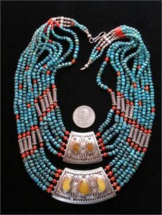 $1875 Extraordinarily beautiful antique Tibetan Tribal Necklace of old butterscotch amber set in elegantly ornate silver center pendants. Strands were restrung  since old threads disintegrated long ago. Rich Turquoise beads and natural red coral beads on either side. Ten gorgeous strands in all  Wearable, Collectible, Museum Quality.