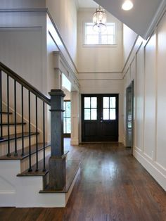 open entry and solid staircase. Looks like updated Mom and Dads house