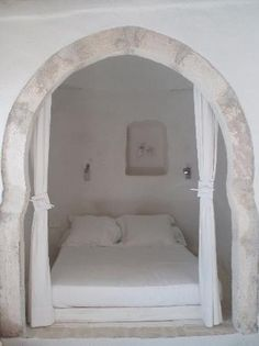 Maybe not with the archway but I really like the idea of the bed in a separate area that can be closed off