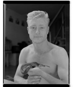 Marcus Bunyan black and white archive: South Yarra and surrounds, 1994 http://wp.me/pn2J2-4ew Dr Marcus Bunyan. Photo: Marcus Bunyan. 'Damien with snake' 1994