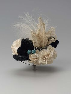 Hat, 1900-1910, American, made of cotton, silk, lace, and feathers.
