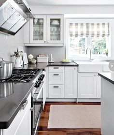 This is exactly the palette/mix of materials I want in my kitchen. With some red accents, I'll be in heaven!