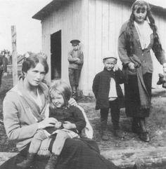 Grand Duchess Olga and Anastasia with Russian peasant children