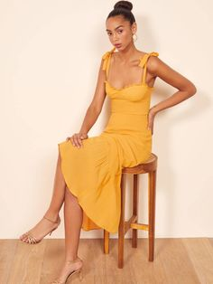 Where do you think you're going? This is a midi length dress with a ruffle edged neckline, strap ties, and a trumpet skirt. The Nikita is fitted in the bodice with an easy fitting skirt. Mode Outfits, Casual Outfits, Trumpet Skirt, Georgette Fabric, Yellow Dress, Yellow Saree, Ladies Dress Design, Ruffle Dress, Spring Outfits