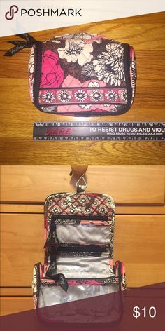 Vera Bradley travel bag Vera Bradley small travel bag/shower caddy in pink pattern. Great for weekends and airport traveling. Multiple zippers, pockets and hook for hanging it up. In great condition and perfect for a young girl. Dimensions about 6.5 inches by 5.5 inches. Vera Bradley Bags Travel Bags
