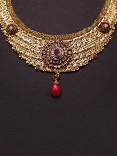 Golden textured  set  in Red enamel, bead and white stone
