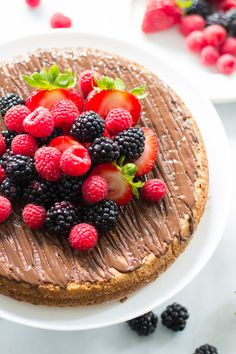 This gluten and dairy free almond cake with berries is made with almond flour and it is fluffy, light, and very moist cake! primaverakitchen.com