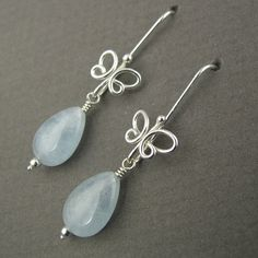 Butterfly Drop Earrings (2011)  Sterling silver, aquamarine  Formed, flame-worked, cold-joined  L 3.8 cm x W 1.0 cm