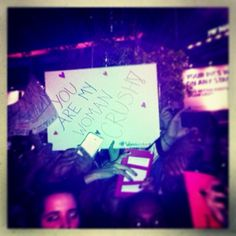 <3 haha girl at the Selena Gomez concert made this sign and is talking about Sel as her woman crush!! Haha