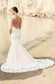 Mikaella Bridal wedding dress | Style 2103, Mikaella Lace Wedding Dress. Mikaella Lace gown with deep V-neckline bodice and double crossover spaghetti straps attached at back. Fit and flare lace skirt.