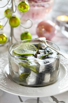 Limettiset maustesilakat // Baltic Herring with lime Food & Style Emilia Kolari Photo Satu Nyström Maku www. Fish Recipes, Recipies, Christmas Baskets, Christian Christmas, Fish And Seafood, Yule, Christmas Time, Panna Cotta, Pudding