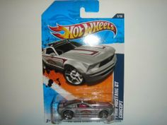 2011 Hot Wheels Ford Mustang GT Concept Grey #162/244 by Mattel. $0.51. HW Main Street '11 Series, #2/10. 1:64. Excellent Condition. Never Removed From Package. Shipped 1st Class Mail With Delivery Confirmation In A Box.