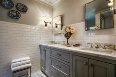Serene and sophisticated guest bathroom with his and hers sinks and subway tile.