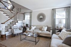 Neutral living room... great mix of pattern, wood and metals.