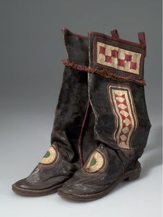 Africa | Boots from the Malinke people of Liberia | Hide, wood, metal, cloth and pigment | ca. 1939.