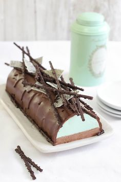 Mint Chocolate Cheesecake w/ Chocolate Mousse - I'll never make it into a log, but I like the combo of flavors. Oreo crust w/ this on top?