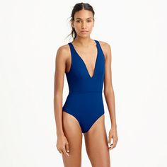 This high-quality one-piece is crafted in a soft, stretchy fabric from a top Italian mill that puts its swim materials through rigorous testing (think dunks in chlorinated water and 20 hours of UV exposure) to ensure vibrant colors and resistance to pilling. This fabric in particular also features UPF 50 sun protection, which is like sunscreen for your clothes. | OPEN-BACK ONE-PIECE SWIMSUIT IN ITALIAN MATTE | jcrew.com