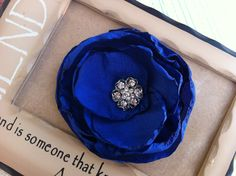 Sapphire Blue Horizon Wedding Bridal Party Hair Clip or Brooch Rose with Rhinestone center Facsinator.... $16.95, via Etsy.