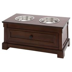 Bring a classic touch to meal time with this wood pet diner, featuring a paneled design and 2 steel bowls.  Product: Pet diner