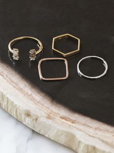 MINIMAL + CLASSIC: Less is more—Bing Bang's delicate stacked set of geometric rings is at once understated and attention-getting.