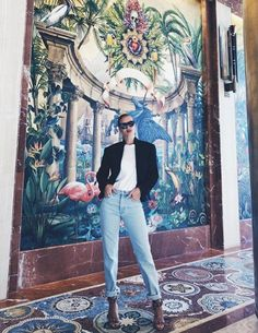 Jeansand awhite T-shirt is hardly a new outfit combination, however Rosie Huntington Whiteley managed to make this look totally fresh this weekend. Rosie opted for a pair of light-wash, straight-leg jeans by Yeezy and then rolled up the cuffs to show the statement ankle straps on her Alaia s...