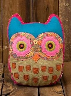Owl pillow with flower shaped eyes