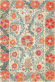 Antique Suzani Embroidery from Uzbekistan  detail - late C 19  Its stylized blooms, are superficially simple, but carry an attention to detail and an understanding of solid composition. Eleven stylized blossoms - ten in the border and one firmly in the center of the field - dance around this beautiful embroidery, driven by the underlying energy infused into the piece by the network of green vinescrolls that adorn the entirety of the yellow-green field...