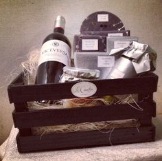 """Coporate Collection: The Tostas Basket This is an ideal basket we developed for Audi in Puebla, México. It is an assorment of gourmet goat cheeses, and """"lateria"""": mussles (mejillones), sardines and evers (angulas), olives, herb paté, wine and tostas! $680 Christmas Gift Baskets, Christmas Gifts, Wine Baskets, Olives, Wine Rack, Goat, Audi, Herbs, Gift Ideas"""