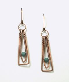 Woven copper wire with magnesite turquoise bead accent dangle earrings.  The double wire frame has been hand shaped, hammered, sanded and polished specifically for the bead size along with the ear wir