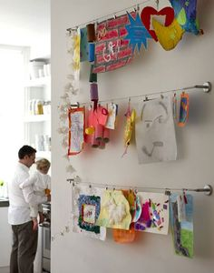 Hang Kids' Art from a Curtain Rod (gotta get to Ikea for this wire rod)